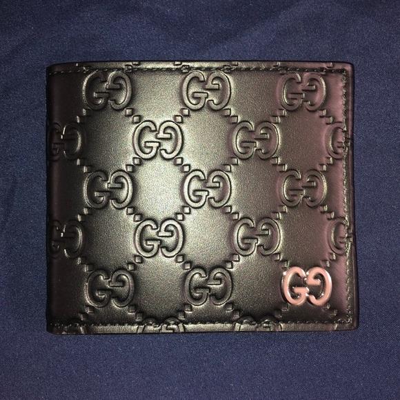 2aa09528fb6 Gucci men s embossed GG Leather Bifold Wallet. Gucci.  M 5c8ccaa4aaa5b8acbddb2333. M 5c8ccaaa9539f760416994ea.  M 5c8ccabb6197455092d16de2